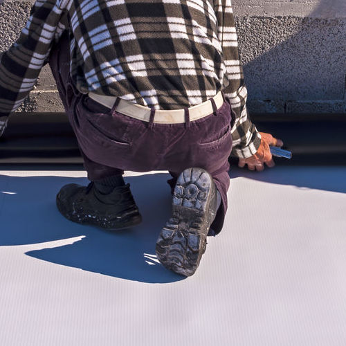 A Roofer Installing Single-Ply TPO.