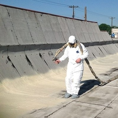 A Roofer Sprays on Foam Roofing