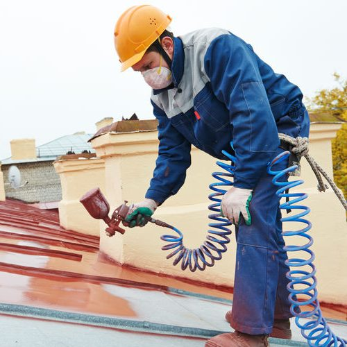 Roof Applying Pulverizer Spray Paint on Metal Sheet Roof