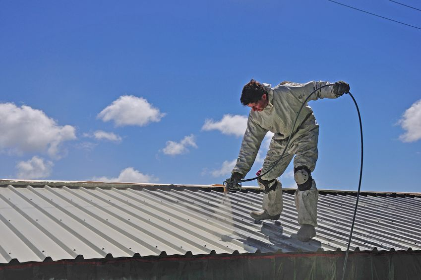 Roofer Applies Airless Spray to Building